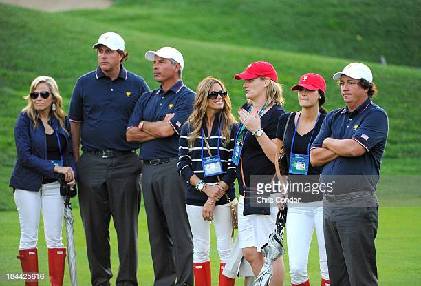 Amy Mickelson Phil Mickelson US Team captain Fred Couples Nadine Moze Kim Johnson Amanda Dufner and Jason Dufner of the US Team follow the play...