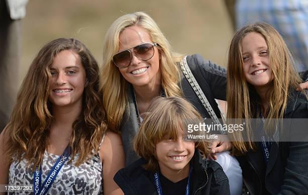 Amy Mickelson poses with children Evan Amanda and Sophia during the third round of the Aberdeen Asset Management Scottish Open at Castle Stuart Golf...