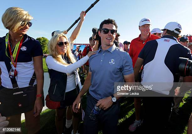 Amy Mickelson speaks to Rory McIlroy of Europe after the United States defeated Europe during singles matches of the 2016 Ryder Cup at Hazeltine...