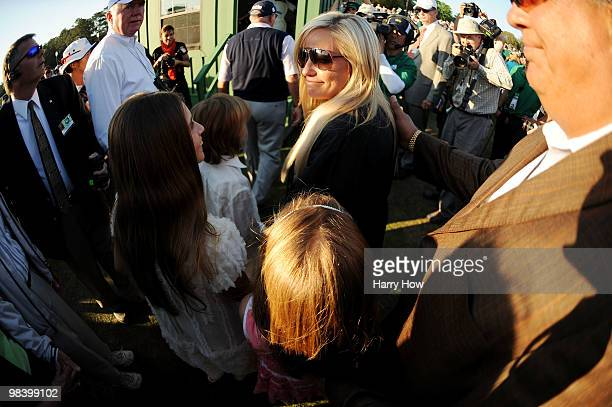 Amy Mickelson waits with her children Amanda Evan and Sophia after Phil Mickelson's threestroke victory at the 2010 Masters Tournament at Augusta...