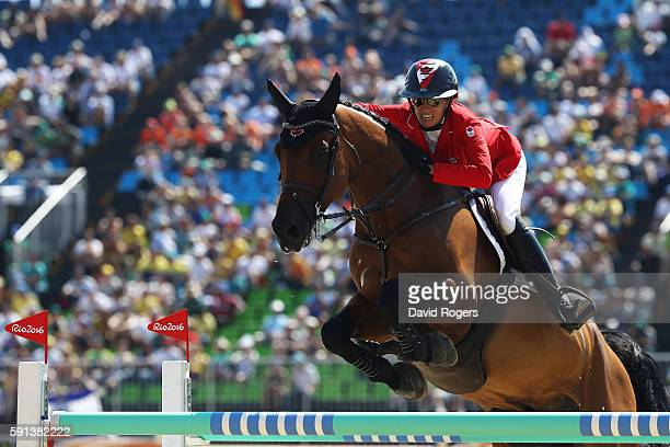 Amy Millar of Canada rides Heros during the Jumping Team Jump-Off for bronze on Day 12 of the Rio 2016 Olympic Games at the Olympic Equestrian Centre...