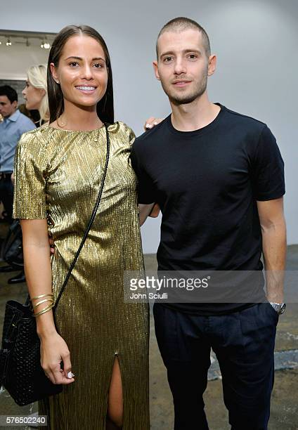 Amy Morris and Julian Morris attend Landon Ross ARTIfACT exhibition opening at LAXART on July 14 2016 in Los Angeles California