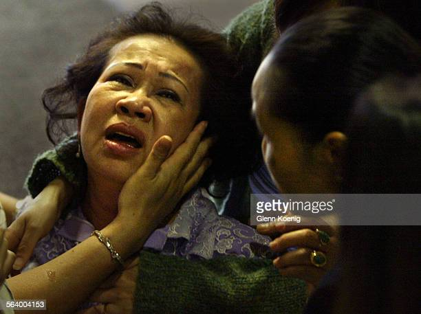 Amy Ngo a sister of murder victim Ha Smith was assisted by family and friends after she colllaped during the press conference in Fountain Valley A...