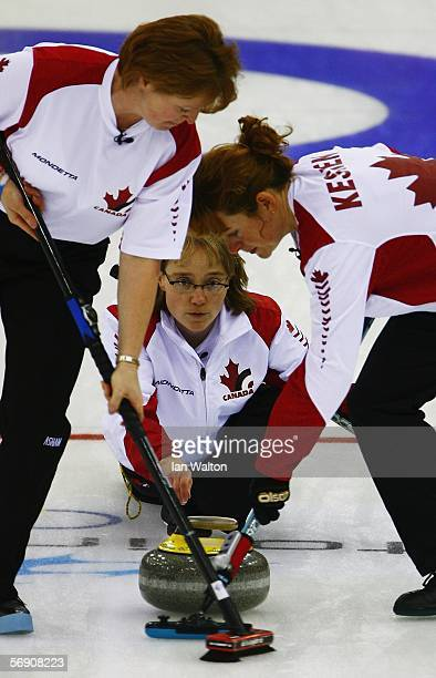 Amy Nixon during of Canada follows her throw during the semi-final of the Women's curling between Switzerland and Canada during Day 12 of the Turin...