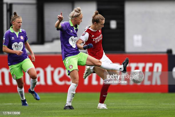 Amy Palmer of Bristol City battles for possession with Vivanne Miedema of Arsenal FC during the Barclays FA Women's Super League match between...