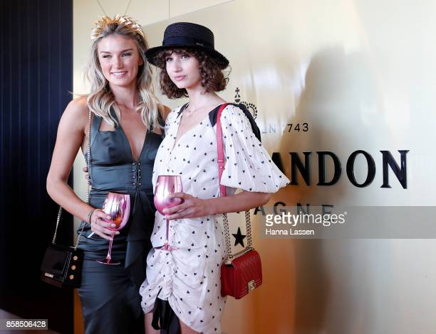 Amy Pejkovic wearing Mimco Clutch and Roberto Pecoraro wearing Nerida Winter boater Zimmerman dress and Chanel clutch at Moet Chandon Spring Champion...