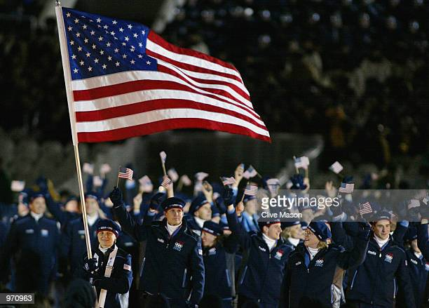 Amy Peterson, short track speed skater, of the USA carries the US flag as they enter the stadium during the Opening Ceremony of the Salt Lake City...