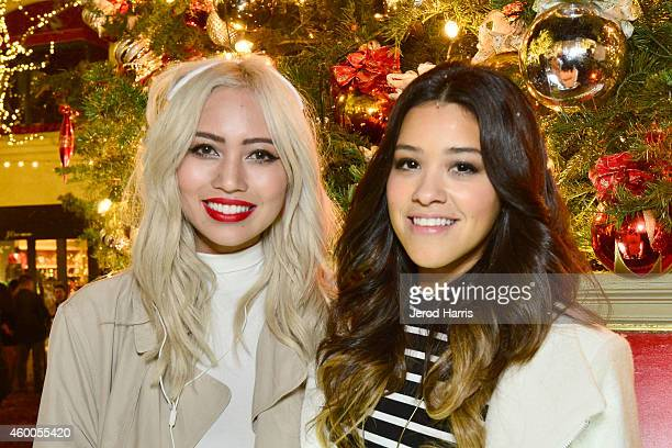 Amy Pham and actress Gina Rodriguez attend the #KiplingHoliday Make Happy Tour at The Grove on December 5 2014 in Los Angeles California