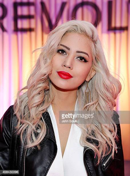 Amy Pham attends and performs at the REVOLVE PopUp Launch Party at The Grove on November 4 2014 in Los Angeles California