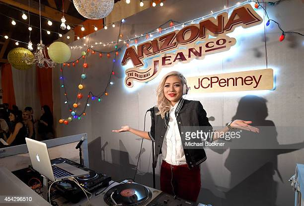 Amy Pham spins at a VIP event hotsted by ARIZONA JEAN CO in Los Angeles with Tori Kelly and Becky G at The Bookbindery on August 27 2014 in Culver...