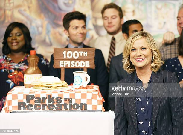 Amy Poehler and the cast of Parks And Recreation attend the their 100th episode celebration held at CBS Studios Radford on October 16 2013 in Studio...