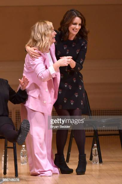Amy Poehler and Tina Fey perform onstage during ASSSSCAT with the Upright Citizens Brigade Live at Carnegie Hall celebrating the 20th Anniversary of...
