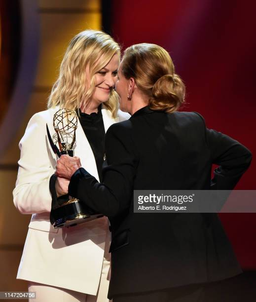 Amy Poehler presents Judge Judy with the Lifetime Achievement Award onstage at the 46th annual Daytime Emmy Awards at Pasadena Civic Center on May 05...