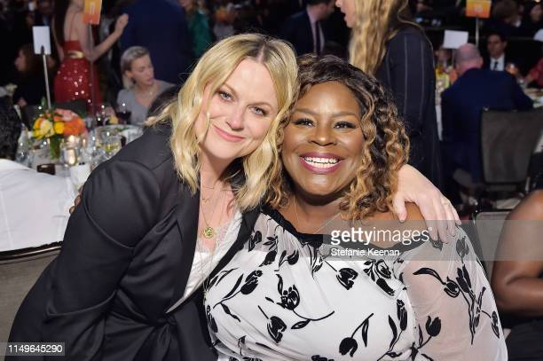 Amy Poehler wearing Max Mara and Retta attend the 2019 Women In Film Annual Gala Presented by Max Mara with additional support from partners Delta...