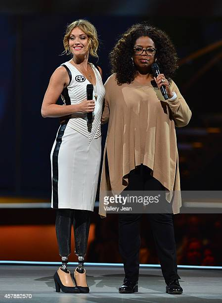 Amy Purdy and Oprah onstage at Oprahs The Life You Want Weekend at American Airlines Arena on October 25 2014 in Miami Florida