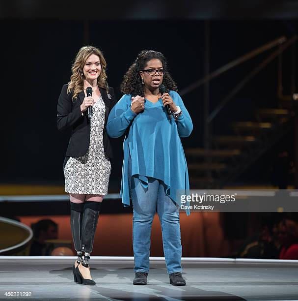 Amy Purdy and Oprah Winfrey attend the Oprah's The Life You Want Weekend Day 2 at Prudential Center on September 27 2014 in Newark New Jersey