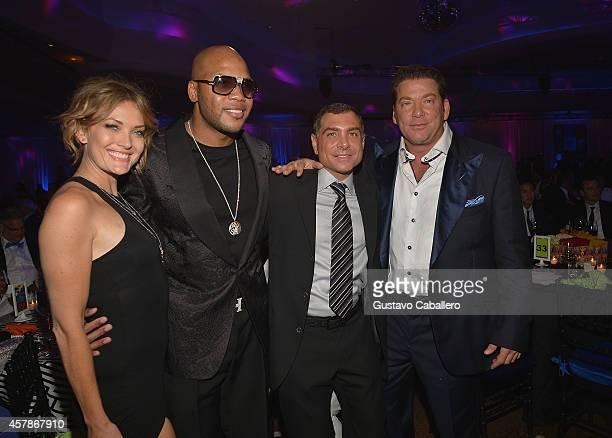 Amy Purdy Flo Rida Antonio Misuraca and Steven Mariano attend The Blacks' Annual Gala at Fontainebleau Miami Beach on October 25 2014 in Miami Beach...