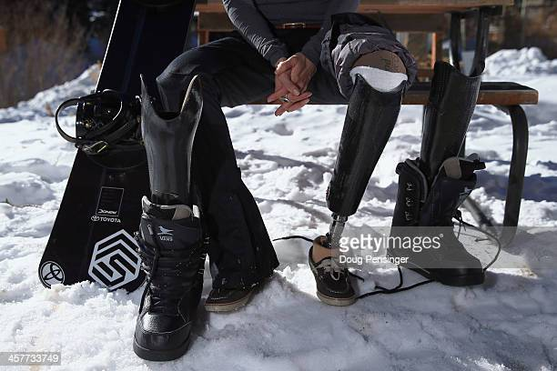 Amy Purdy prepares to swap her prosthetic legs for a training session on December 16 2013 in Copper Mountain Colorado Purdy is a a member of the US...