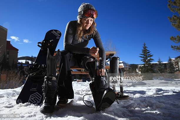 Amy Purdy swaps her prosthetic legs as she prepares for a training session on December 16 2013 in Copper Mountain Colorado Purdy is a a member of the...
