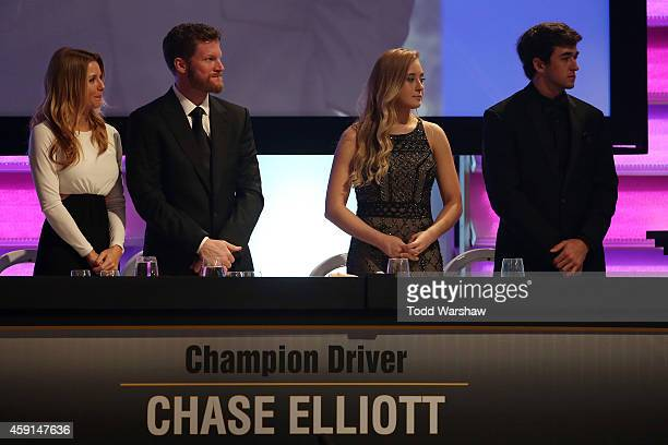 Amy Reimann Dale Earnhardt Jr Erin Bailey and Chase Elliott look on during the NASCAR Nationwide Series and NASCAR Camping World Truck Series Banquet...