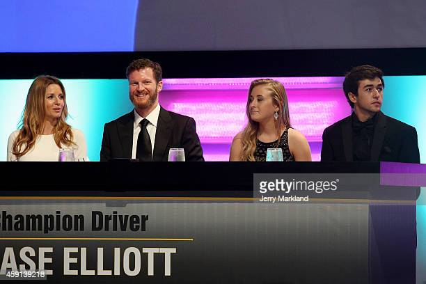 Amy Reimann Dale Earnhardt Jr Erin Blaney and Chase Elliott sit on stage during the NASCAR Nationwide Series and NASCAR Camping World Truck Series...