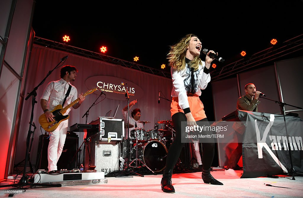 Amy Renee Heidemann and Nick Noonan of Karmin perform onstage during the 13th Annual Chrysalis Butterfly Ball sponsored by Audi, Kayne Anderson and Stella Artois in Los Angeles, California on June 7th, 2014.
