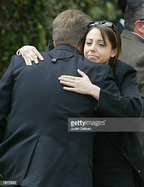 Amy Rocha sister of Laci Peterson hugs an unidentified man before entering a memorial service for Laci Peterson and her unborn son Connor May 4 2003...