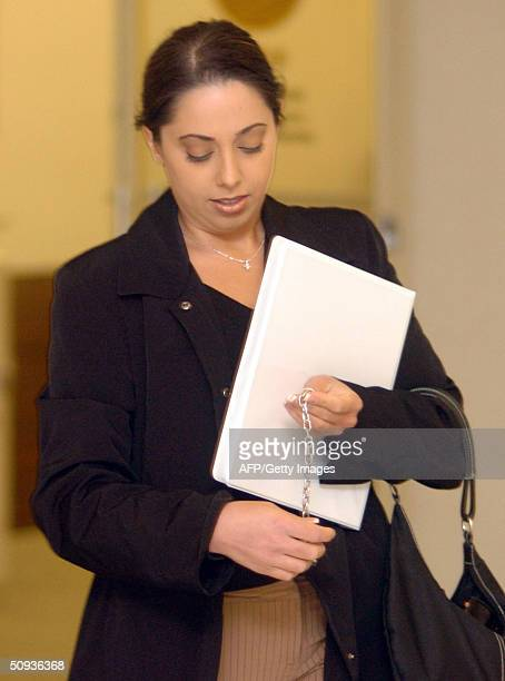 Amy Rocha sister of Laci Peterson makes her way to the courtroom at the San Mateo County Superior Courthouse 07 June 2004 in Redwood City California...