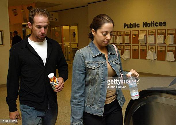 Amy Rocha sister of murdered woman Laci Peterson walks with an unidentified man as they arrive at the San Mateo Superior Court October 4 2004 in...