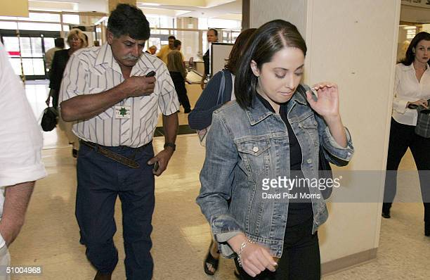 Amy Rocha the sister of Laci Peterson and Dennis Rocha the father of Laci Peterson enter the San Mateo County Courthouse for the trial of Scott...