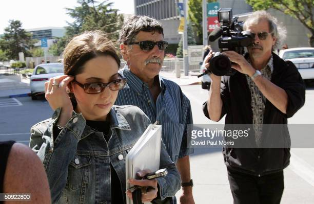 Amy Rocha with her and Laci Petersons father Dennis Rocha leave the the San Mateo County Courthouse in Redwood City California on June 3 2004 for the...