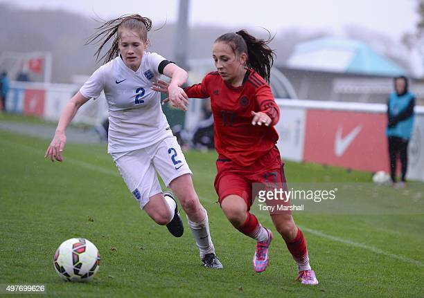 Amy Rodgers of England tackles Gina Chmielinski of Germany during Women's U16s International Friendly match between England U16s Women and Germany...