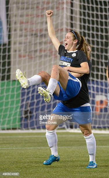Amy Rodriguez lifts up Heather O'Reilly of FC Kansas City after FC Kansas City won the NWSL Championship 10 against the Seattle Reign FC at...