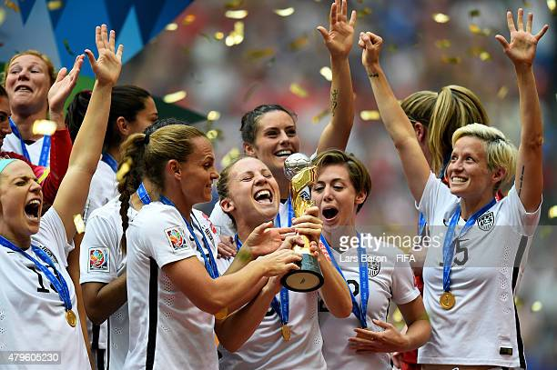 Amy Rodriguez of USA celebrates with the trophy after winning the FIFA Women's World Cup 2015 Final between USA and Japan at BC Place Stadium on July...