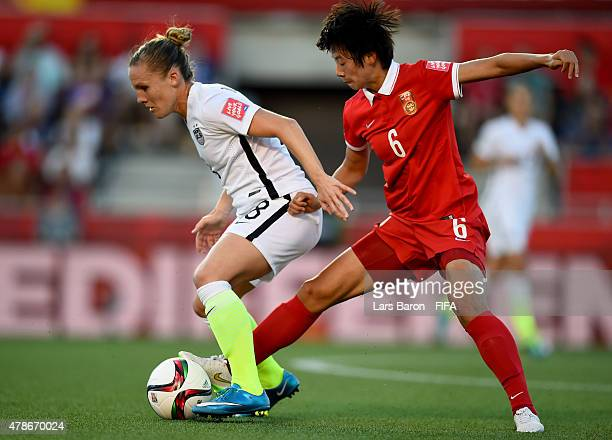 Amy Rodriguez of USA is challenged by Gongna Li of China during the FIFA Women's World Cup 2015 Quarter Final match between China and United States...