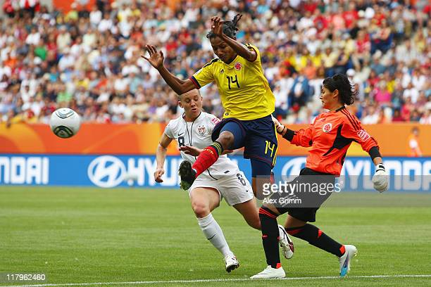 Amy Rodriguez of USA is challenged by Kelis Peduzine and Goalkeeper Sandra Sepulveda of Colombia during the FIFA Women's World Cup 2011 Group C match...