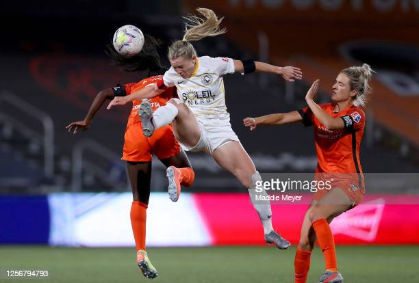 Amy Rodriguez of Utah Royals FC heads the ball against Nichelle Prince of the Houston Dash during the second half in the quarterfinal match of the...