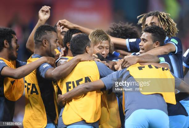 Amy Roine of Hienghene Sport celebrates with teammates after scoring his team's first goal during the FIFA Club World Cup Qatar 2019 match between...
