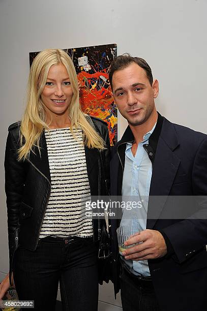 Amy Ruby and Jonathan Tchaikovsky attend Aelita Andre Exhibit Opening Night at Gallery 151 on October 28 2014 in New York City