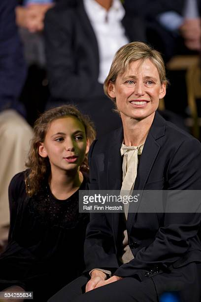 Amy Rule wife of former White House Chief of Staff Rahm Emanuel and their daughter Ilana watch as Emanuel announces his candidacy for Mayor of Chicago