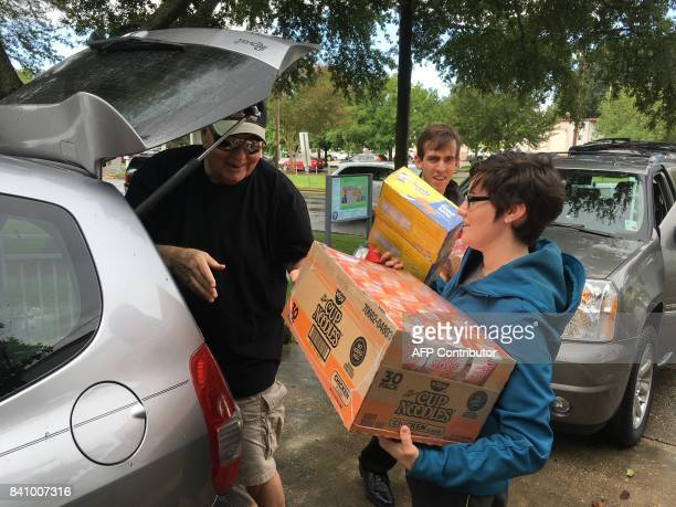 Amy Runco receives packages of food and supplies from a donor on August 30 in Jefferson parish near New Orleans bound for victims of Hurricane Harvey...
