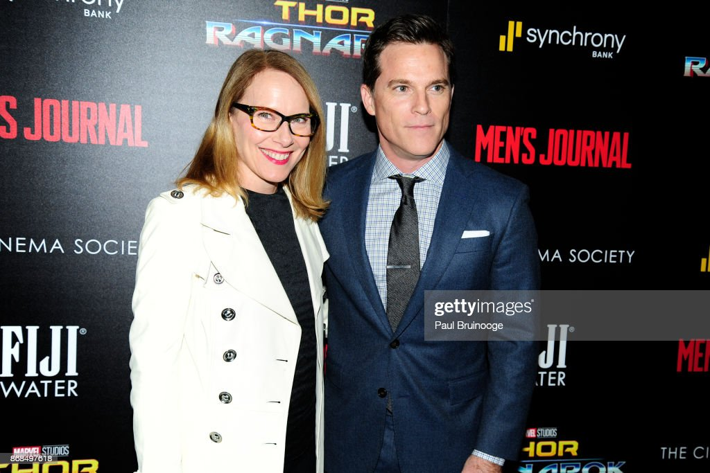 Amy Ryan and Mike Doyle attend The Cinema Society with FIJI Water, Men's Journal, and Synchrony host a screening of Marvel Studios' 'Thor: Ragnarok' at the Whitby Hotel on October 30, 2017 in New York City.