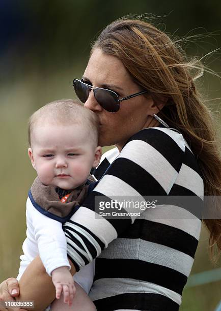 Amy Sabbatini wife of PGA Tour golfer Rory Sabbatini holds son Bodhi during the final round of The Honda Classic at PGA National Resort and Spa on...