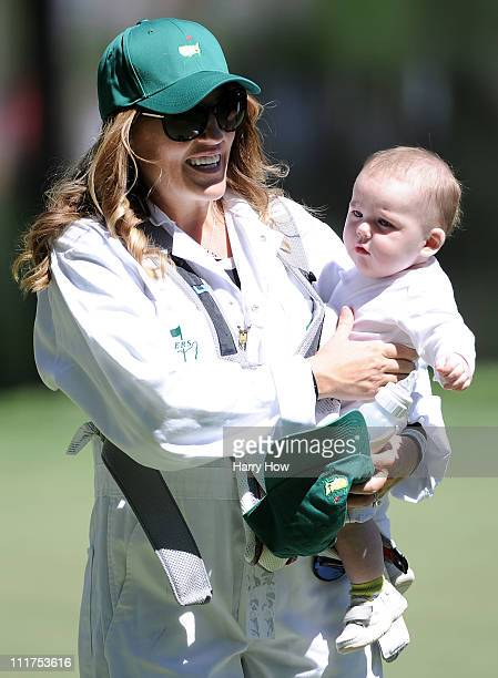 Amy Sabbatini wife of Rory Sabbatini of South Africa holds their son Bodie during the Par 3 Contest prior to the 2011 Masters Tournament at Augusta...