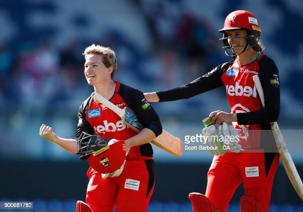Amy Satterthwaite and Jess Cameron celebrate hitting the winning runs on the final ball in a super over during the Women's Big Bash League match...