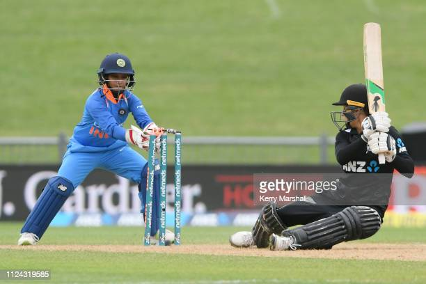 Amy Satterthwaite of New Zealand is stumped by Taniya Bhatia of India during game one of the One Day International Series between New Zealand White...