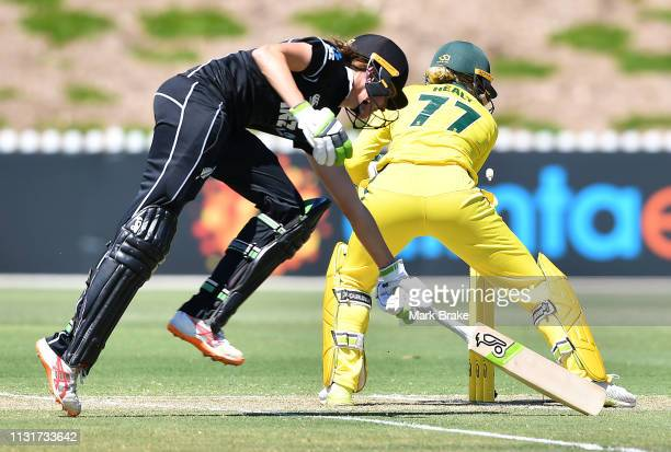 Amy Satterthwaite of New Zealand makes her crease as Alyssa Healy of Australia takes off the bails during game two of the One Day International...