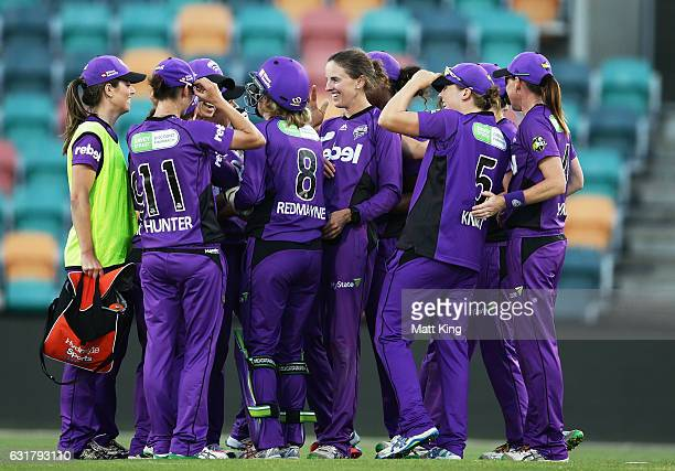 Amy Satterthwaite of the Hurricanes celebrates with team mates after taking a hattrick with the wicket of Lauren Cheatle of the Thunder during the...