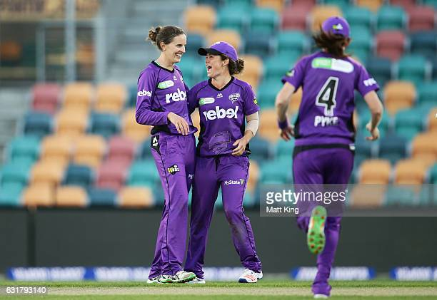 Amy Satterthwaite of the Hurricanes celebrates with team mates after taking the wicket of Rene Farrell of the Thunder during the Women's Big Bash...