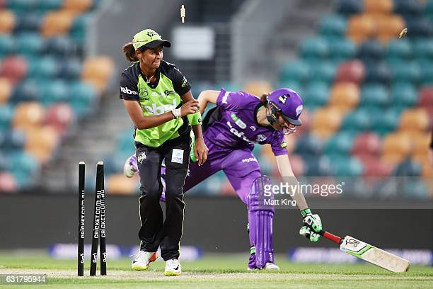 Amy Satterthwaite of the Hurricanes is run out by Harmanpreet Kaur of the Thunder during the Women's Big Bash League match between the Hobart...